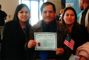 Monica with her father and sister at her father's naturalization ceremony